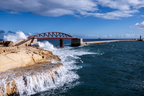 Valletta, Breakwater Bridge struck by a wave, Malta
