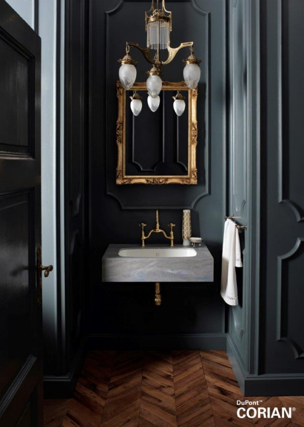 Los tonos veteados de Corian® Juniper envuelven sin juntas el lavabo Corian® Peace.
