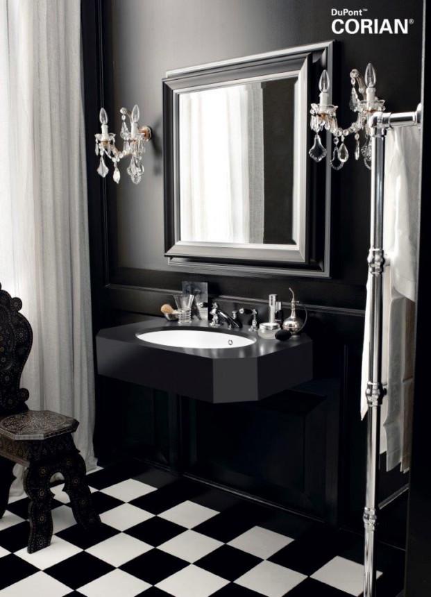 El lavabo  Corian® Relax destaca sobre el negro azabache de Corian® Deep Nocturne.