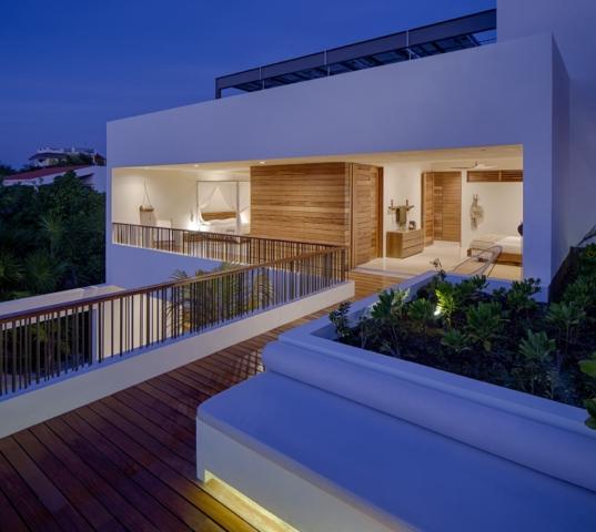 vista nocturna de casa xixim en tulum mexico specht architects diariodesign
