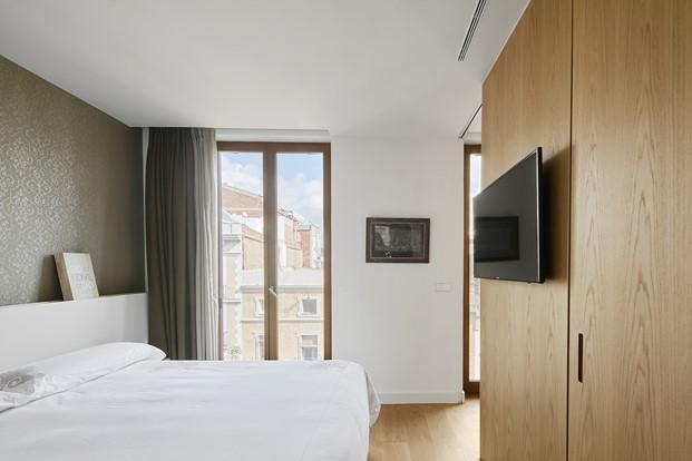 dormitorio La casa por el tejado Barcelona