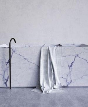 reformas con marmol blanco con vetas para bañera diariodesign
