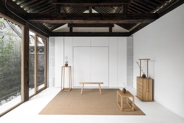 salon de una casa china por Archstudio arquitectos