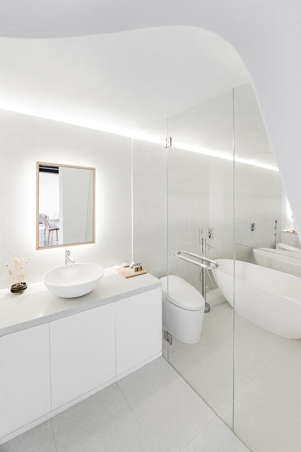 baño de una casa china por Archstudio