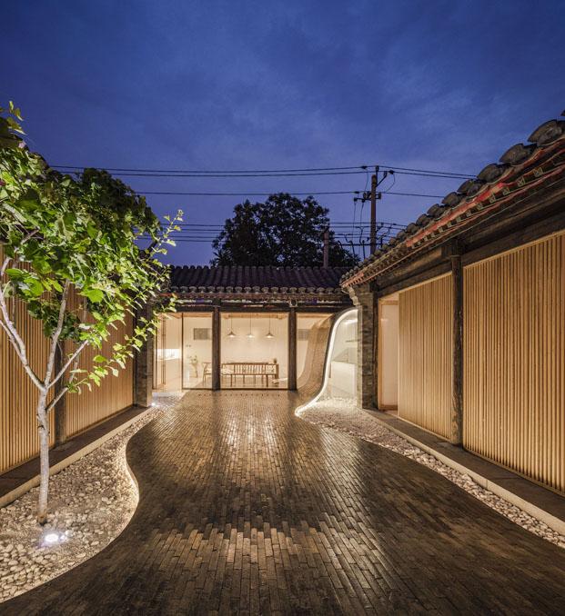 vista nocturna de casa china de Archstudio arquitectos