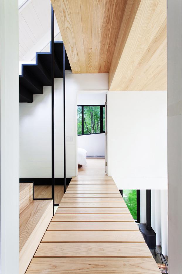 revestimientos de madera en casas en el bosque La Colombiere en Quebec diariodesign