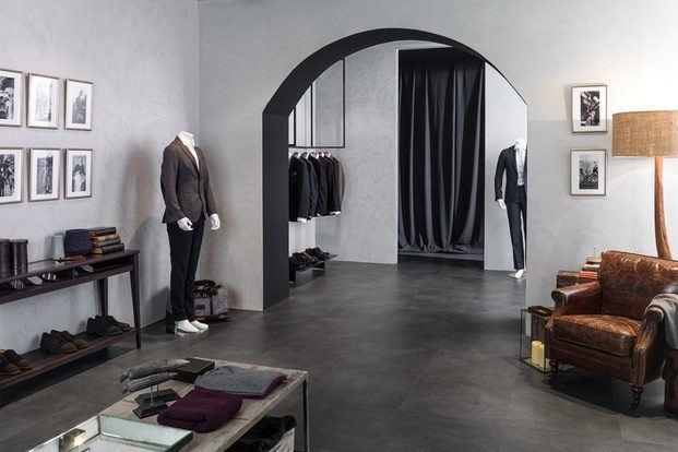 interior tienda ropa hombre suelo cemento gris diariodesign