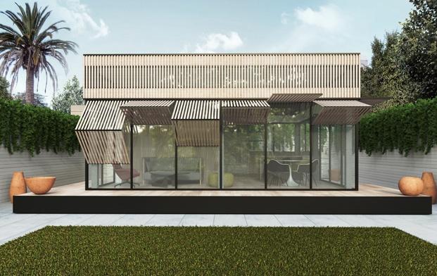 vivienda prefabricada con fachada de vidrio y madera