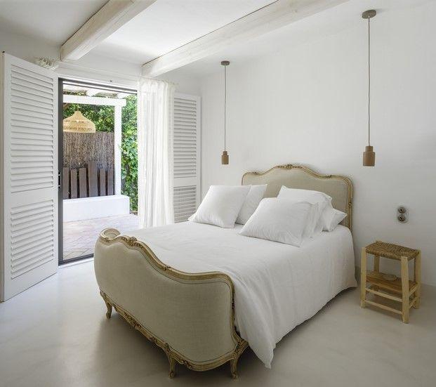 dormitorio decorado con tejidos naturales
