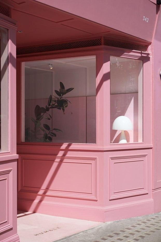 fachada de madera rosa humble pizza diariodesign