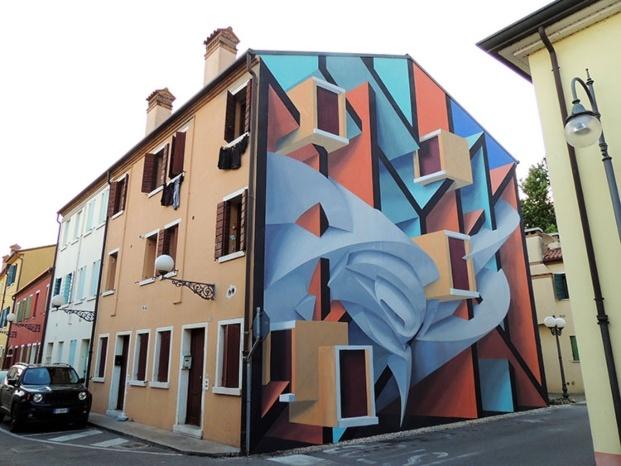 peeta mural fachada edificio color rojo azul