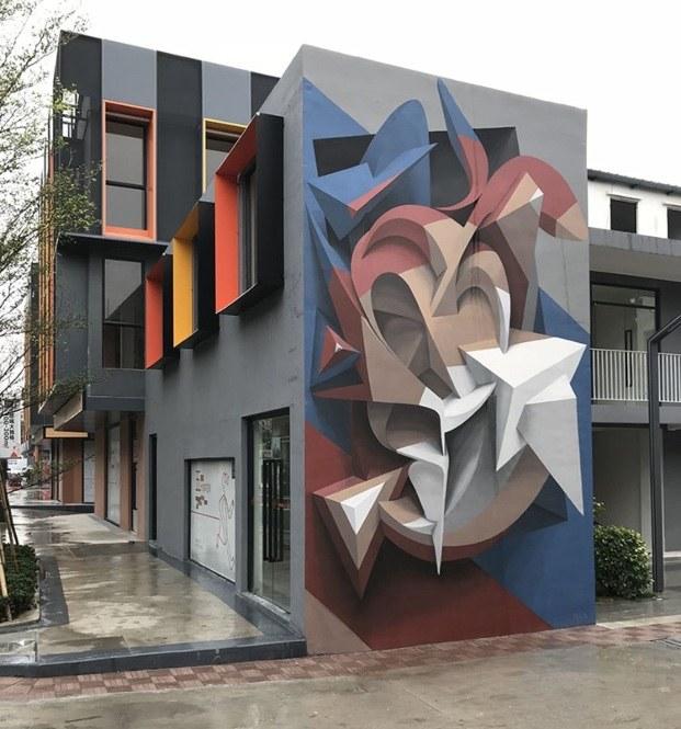 peeta mural edificio formas color azul rojo marrón y blanco