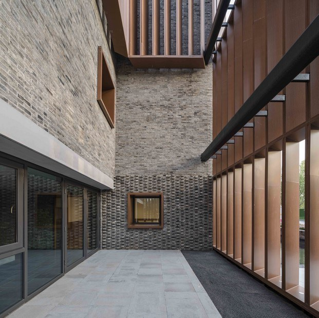 recepción doble altura centro cultural junshan