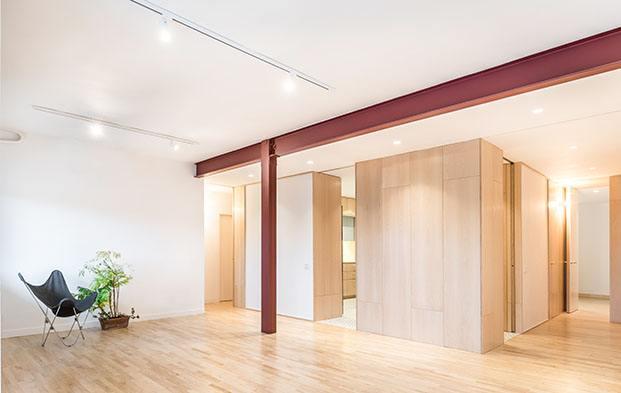 Estudio Minimo. Arquitectos Madrid. Casa minimalista con la cocina en el centro.