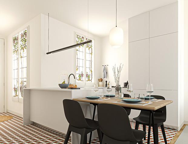 La cocina de las nuevos pisos de Casa Alesan, perfetamente equipada e iluminada con ventanales modernistas